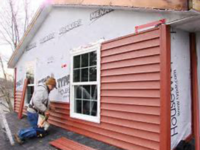 E Esquivel Roofing red siding